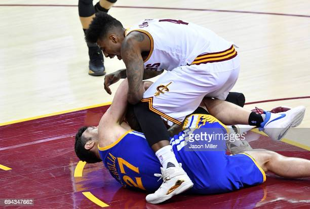 Iman Shumpert of the Cleveland Cavaliers compete for the ball with Zaza Pachulia of the Golden State Warriors in the third quarter in Game 4 of the...