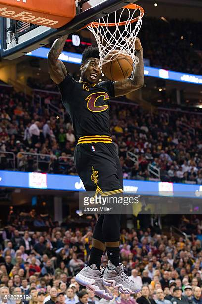 Iman Shumpert of the Cleveland Cavaliers dunks during the second half against the Houston Rockets at Quicken Loans Arena on March 29 2016 in...