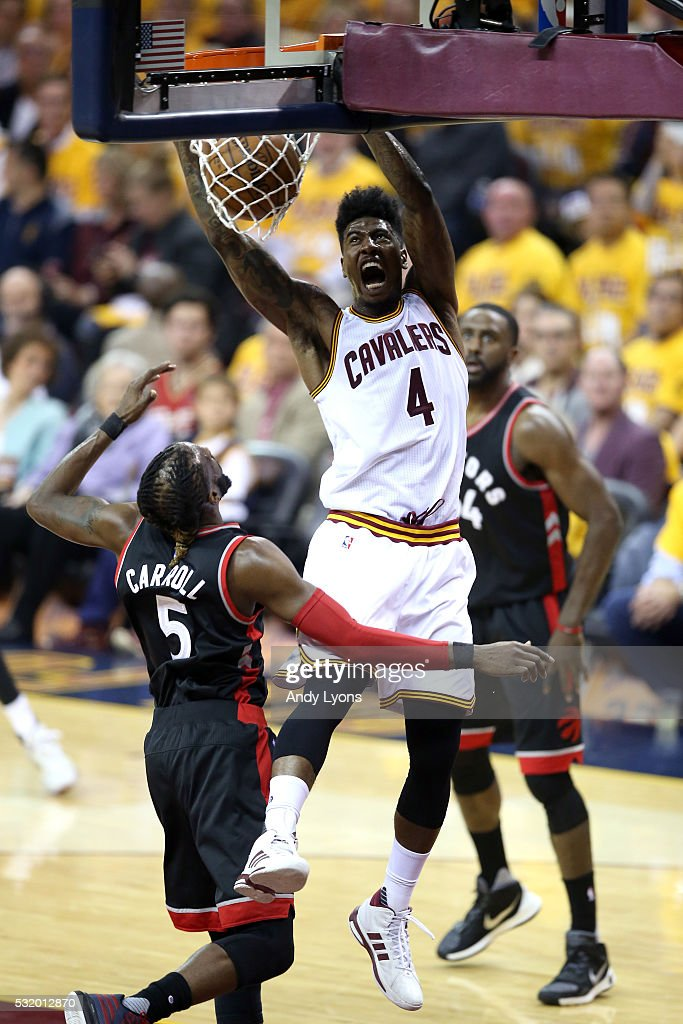 Iman Shumpert #4 of the Cleveland Cavaliers dunks in the second quarter against DeMarre Carroll #5 of the Toronto Raptors in game one of the Eastern Conference Finals during the 2016 NBA Playoffs at Quicken Loans Arena on May 17, 2016 in Cleveland, Ohio.