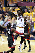 Iman Shumpert of the Cleveland Cavaliers dunks in the second quarter against DeMarre Carroll of the Toronto Raptors in game one of the Eastern...