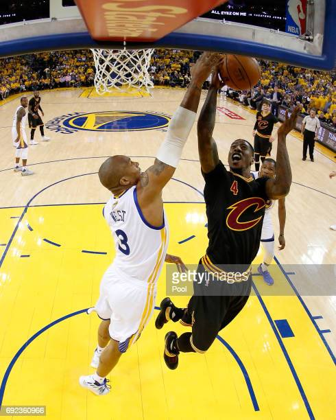 Iman Shumpert of the Cleveland Cavaliers is blocked by David West of the Golden State Warriors in Game 2 of the 2017 NBA Finals at ORACLE Arena on...