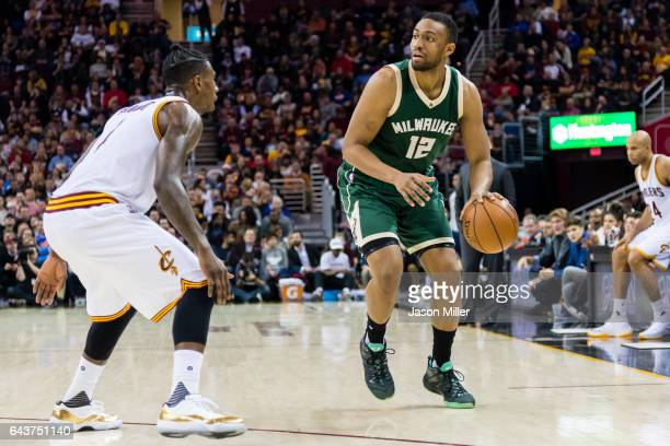 Iman Shumpert of the Cleveland Cavaliers puts pressure on Jabari Parker of the Milwaukee Bucks during the first half at Quicken Loans Arena on...