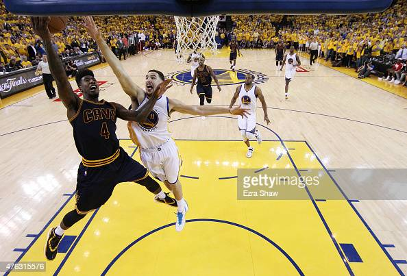 Iman Shumpert of the Cleveland Cavaliers shoots against Klay Thompson of the Golden State Warriors in the second half during Game Two of the 2015 NBA...