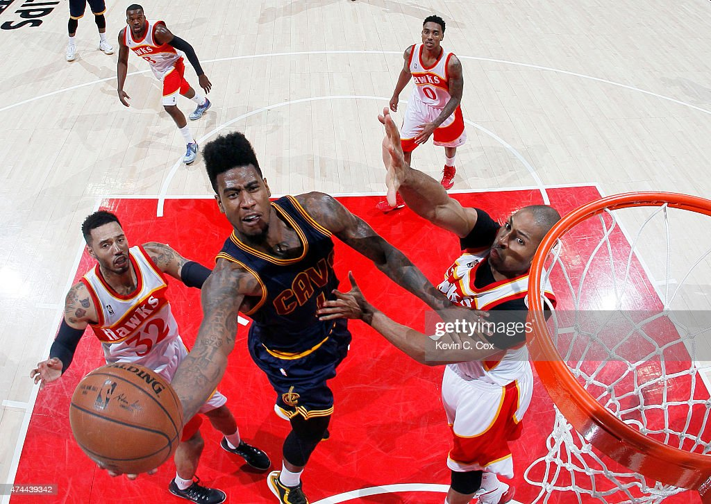 <a gi-track='captionPersonalityLinkClicked' href=/galleries/search?phrase=Iman+Shumpert&family=editorial&specificpeople=5042486 ng-click='$event.stopPropagation()'>Iman Shumpert</a> #4 of the Cleveland Cavaliers shoots against the Atlanta Hawks in the fourth quarter during Game Two of the Eastern Conference Finals of the 2015 NBA Playoffs at Philips Arena on May 22, 2015 in Atlanta, Georgia.