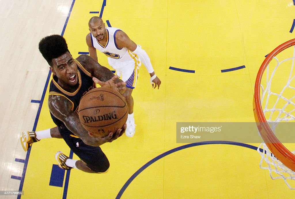 <a gi-track='captionPersonalityLinkClicked' href=/galleries/search?phrase=Iman+Shumpert&family=editorial&specificpeople=5042486 ng-click='$event.stopPropagation()'>Iman Shumpert</a> #4 of the Cleveland Cavaliers shoots against the Golden State Warriors in the first half during Game Five of the 2015 NBA Finals at ORACLE Arena on June 14, 2015 in Oakland, California.