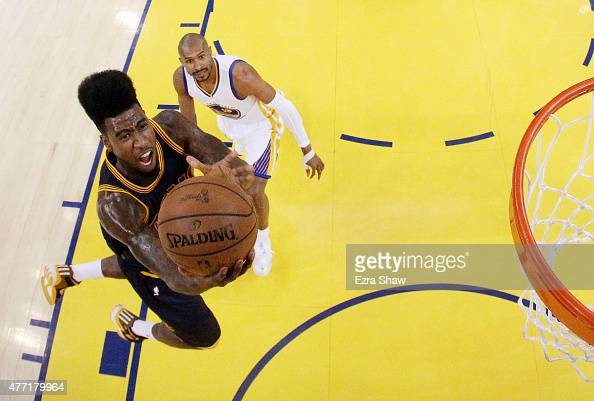 Iman Shumpert of the Cleveland Cavaliers shoots against the Golden State Warriors in the first half during Game Five of the 2015 NBA Finals at ORACLE...