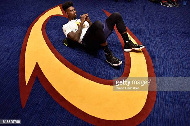 Iman Shumpert of the Cleveland Cavaliers stretches before the game against the New York Knicks on October 25 2016 at Quicken Loans Arena in Cleveland...