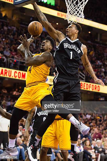 Iman Shumpert of the Cleveland Cavaliers tries to shoot wile under pressure from Chris McCullough of the Brooklyn Nets during the first half at...