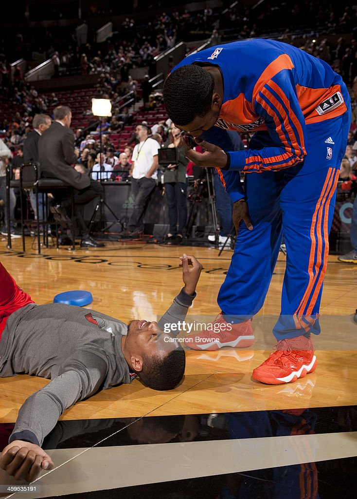 <a gi-track='captionPersonalityLinkClicked' href=/galleries/search?phrase=Iman+Shumpert&family=editorial&specificpeople=5042486 ng-click='$event.stopPropagation()'>Iman Shumpert</a> #21 of the New York Knicks and <a gi-track='captionPersonalityLinkClicked' href=/galleries/search?phrase=Damian+Lillard&family=editorial&specificpeople=6598327 ng-click='$event.stopPropagation()'>Damian Lillard</a> #0 of the Portland Trail Blazers talk before the game on November 25, 2013 at the Moda Center Arena in Portland, Oregon.