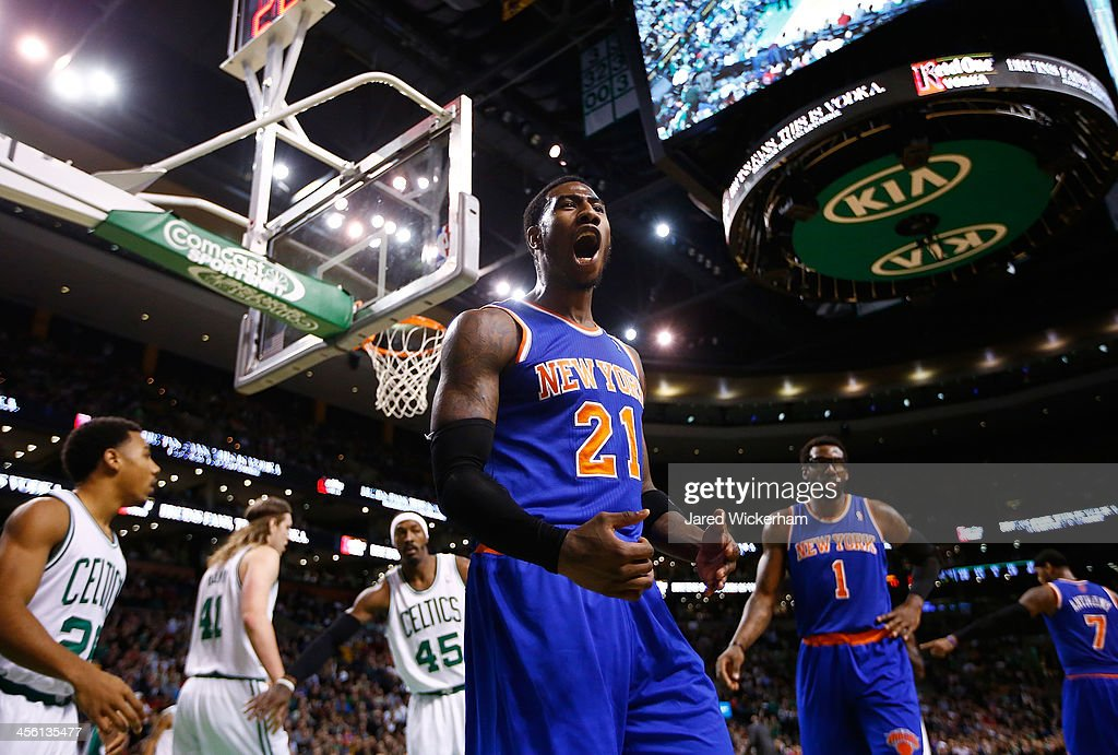 <a gi-track='captionPersonalityLinkClicked' href=/galleries/search?phrase=Iman+Shumpert&family=editorial&specificpeople=5042486 ng-click='$event.stopPropagation()'>Iman Shumpert</a> #21 of the New York Knicks argues a non-call with a referee following a blocked shot in the fourth quarter against the Boston Celtics during the game at TD Garden on December 13, 2013 in Boston, Massachusetts.
