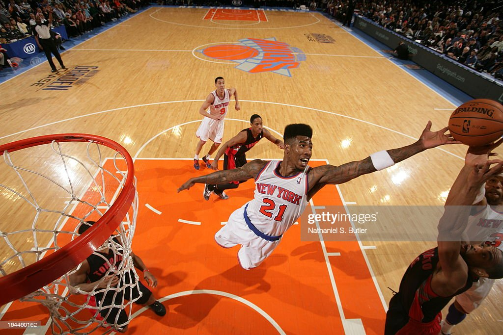 <a gi-track='captionPersonalityLinkClicked' href=/galleries/search?phrase=Iman+Shumpert&family=editorial&specificpeople=5042486 ng-click='$event.stopPropagation()'>Iman Shumpert</a> #21 of the New York Knicks attempts to rebound the ball while playing in a game against the Toronto Raptors on March 23, 2013 at Madison Square Garden in New York City.
