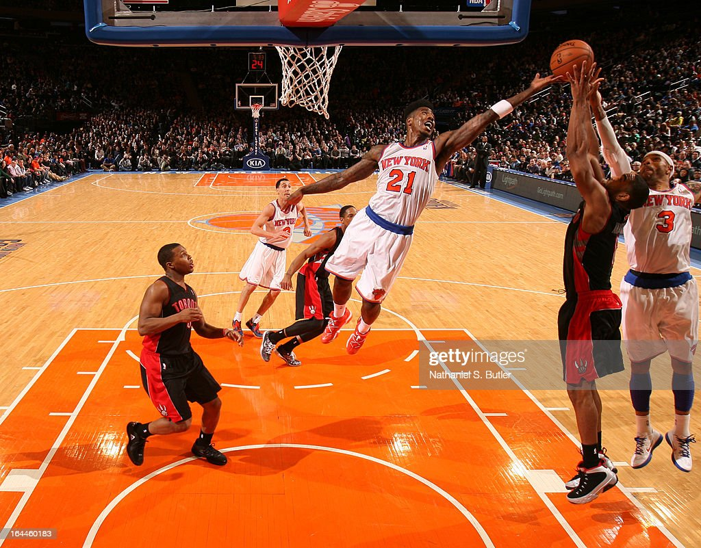Iman Shumpert #21 of the New York Knicks attempts to rebound the ball while playing in a game against the Toronto Raptors on March 23, 2013 at Madison Square Garden in New York City.
