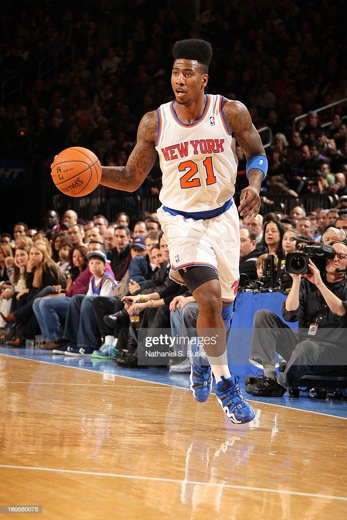 Iman Shumpert #21 of the New York Knicks brings the ball up court against the Sacramento Kings on February 2, 2013 at Madison Square Garden in New York City.