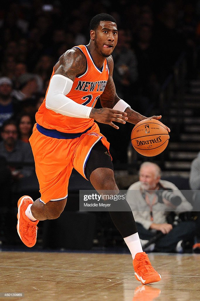 Iman Shumpert #21 of the New York Knicks carries the ball downcourt during the second half against the Atlanta Hawks at Madison Square Garden on November 16, 2013 in New York City. The Hawks defeat the Knicks 110-90.
