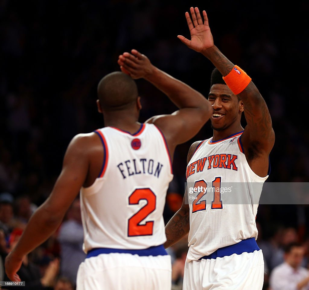 <a gi-track='captionPersonalityLinkClicked' href=/galleries/search?phrase=Iman+Shumpert&family=editorial&specificpeople=5042486 ng-click='$event.stopPropagation()'>Iman Shumpert</a> #21 of the New York Knicks celebrates with teammate <a gi-track='captionPersonalityLinkClicked' href=/galleries/search?phrase=Raymond+Felton&family=editorial&specificpeople=209141 ng-click='$event.stopPropagation()'>Raymond Felton</a> #2 after defeating the Indiana Pacers in Game Five of the Eastern Conference Semifinals of the 2013 NBA Playoffs at Madison Square Garden on May 16, 2013 in New York City. The Indiana Pacers were defeated by the New York Knicks 75-85.