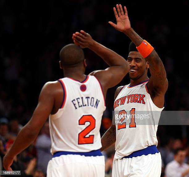 Iman Shumpert of the New York Knicks celebrates with teammate Raymond Felton after defeating the Indiana Pacers in Game Five of the Eastern...