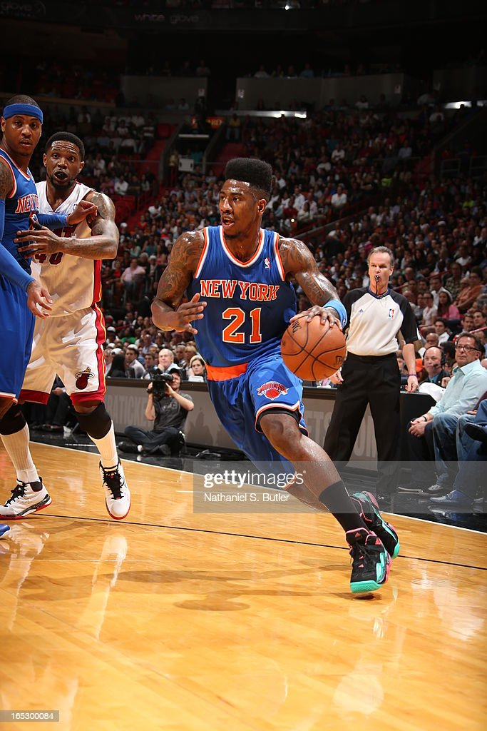 Iman Shumpert #21 of the New York Knicks dribbles the ball up court against the Miami Heat during a game on April 2, 2013 at American Airlines Arena in Miami, Florida.