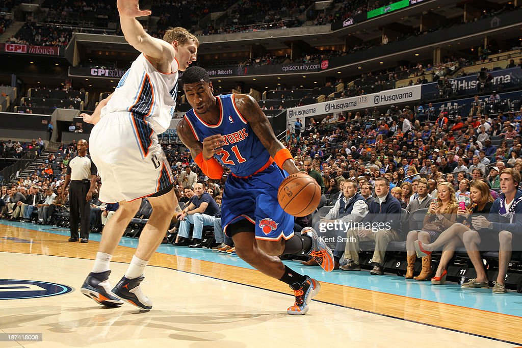 Iman Shumpert #21 of the New York Knicks drives against Cody Zeller #40 of the Charlotte Bobcats at the Time Warner Cable Arena on November 8, 2013 in Charlotte, North Carolina.