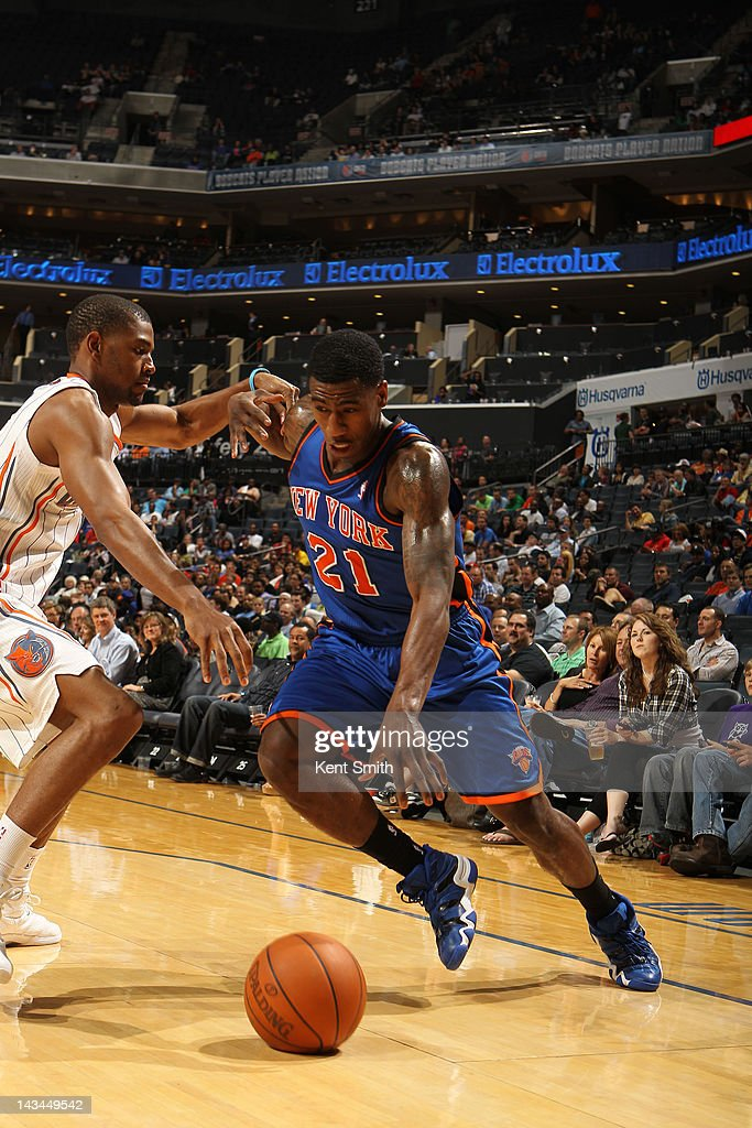 <a gi-track='captionPersonalityLinkClicked' href=/galleries/search?phrase=Iman+Shumpert&family=editorial&specificpeople=5042486 ng-click='$event.stopPropagation()'>Iman Shumpert</a> #21 of the New York Knicks drives against Cory Higgins #11 of the Charlotte Bobcats at the Time Warner Cable Arena on April 26, 2012 in Charlotte, North Carolina.