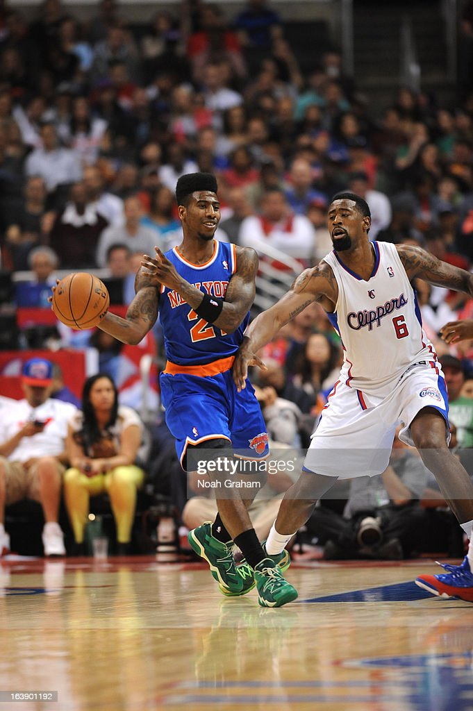 Iman Shumpert #21 of the New York Knicks drives against DeAndre Jordan #6 of the Los Angeles Clippers during the game between the Los Angeles Clippers and the New York Knicks at Staples Center on March 17, 2013 in Los Angeles, California.
