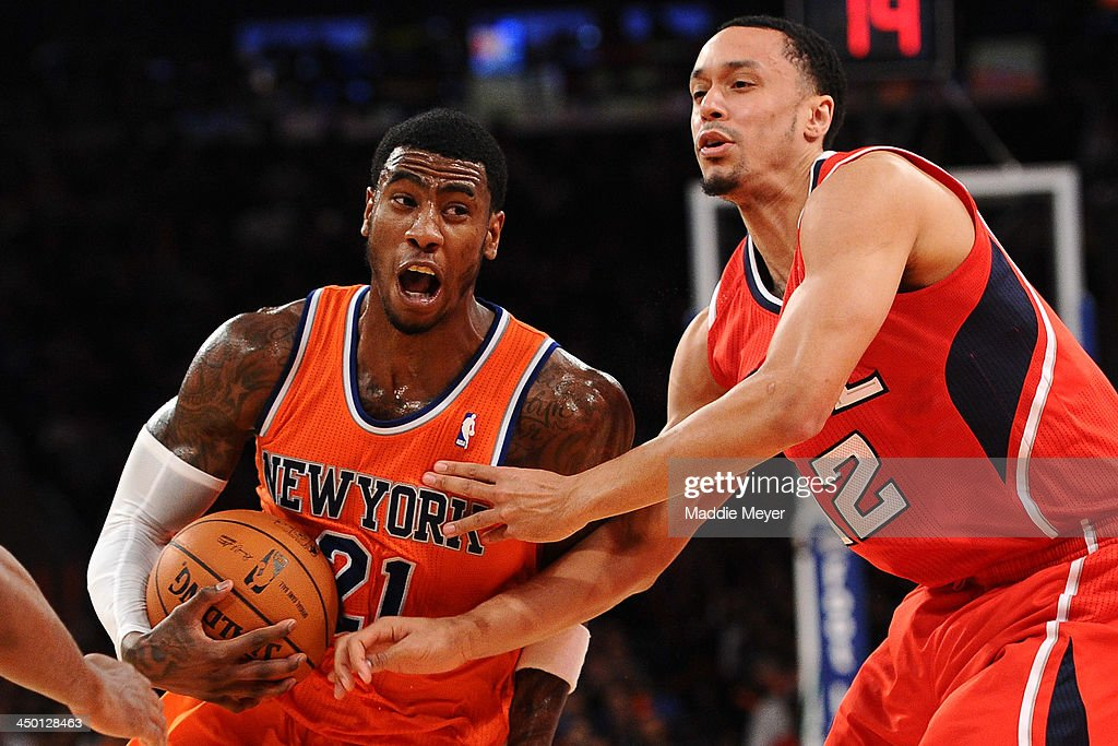 Iman Shumpert #21 of the New York Knicks drives against John Jenkins #12 of the Atlanta Hawks during the second half at Madison Square Garden on November 16, 2013 in New York City. The Hawks defeat the Knicks 110-90.