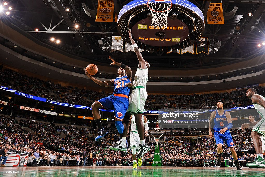 Iman Shumpert #21 of the New York Knicks drives to the basket against Kevin Garnett #5 of the Boston Celtics on January 24, 2013 at the TD Garden in Boston, Massachusetts.