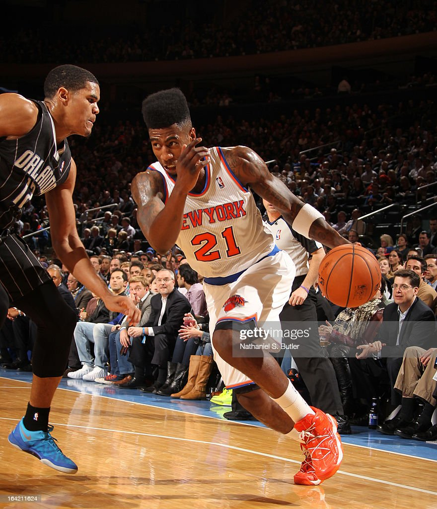 Iman Shumpert #21 of the New York Knicks drives to the basket against Tobias Harris #12 of the Orlando Magic on March 20, 2013 at Madison Square Garden in New York City.