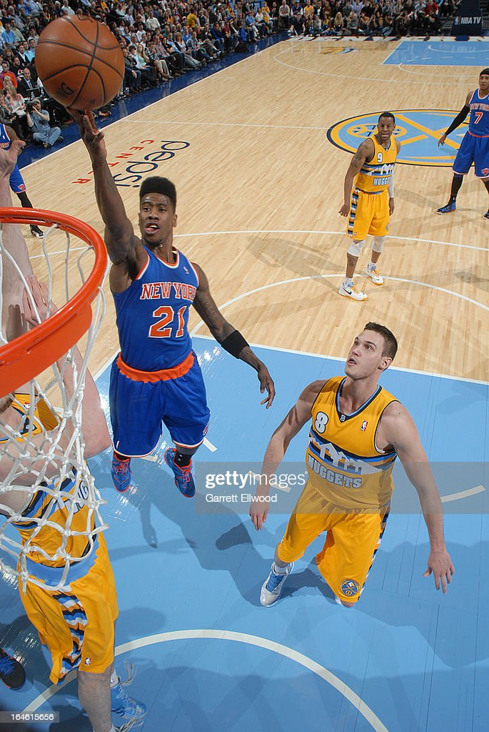 Iman Shumpert #21 of the New York Knicks drives to the basket against the Denver Nuggets on March 13, 2013 at the Pepsi Center in Denver, Colorado.