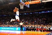 Iman Shumpert of the New York Knicks dunks the ball during a game against the Atlanta Hawks at Madison Square Garden on November 10 2014 in New York...