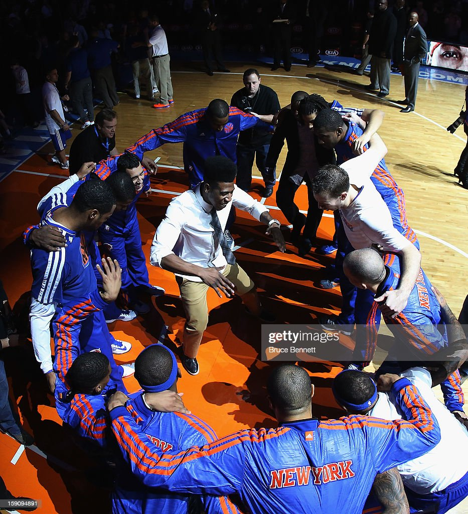 <a gi-track='captionPersonalityLinkClicked' href=/galleries/search?phrase=Iman+Shumpert&family=editorial&specificpeople=5042486 ng-click='$event.stopPropagation()'>Iman Shumpert</a> #21 of the New York Knicks gets in the middle of the circle during the pregame introuctions prior to the game against the Boston Celtics at Madison Square Garden on January 7, 2013 in New York City.