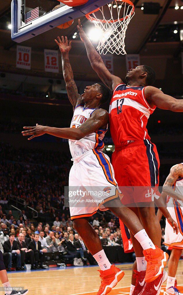 <a gi-track='captionPersonalityLinkClicked' href=/galleries/search?phrase=Iman+Shumpert&family=editorial&specificpeople=5042486 ng-click='$event.stopPropagation()'>Iman Shumpert</a> #21 of the New York Knicks goes to the basket against <a gi-track='captionPersonalityLinkClicked' href=/galleries/search?phrase=Kevin+Seraphin&family=editorial&specificpeople=6474998 ng-click='$event.stopPropagation()'>Kevin Seraphin</a> #13 of the Washington Wizards during the game on April 13, 2012 at Madison Square Garden in New York City.