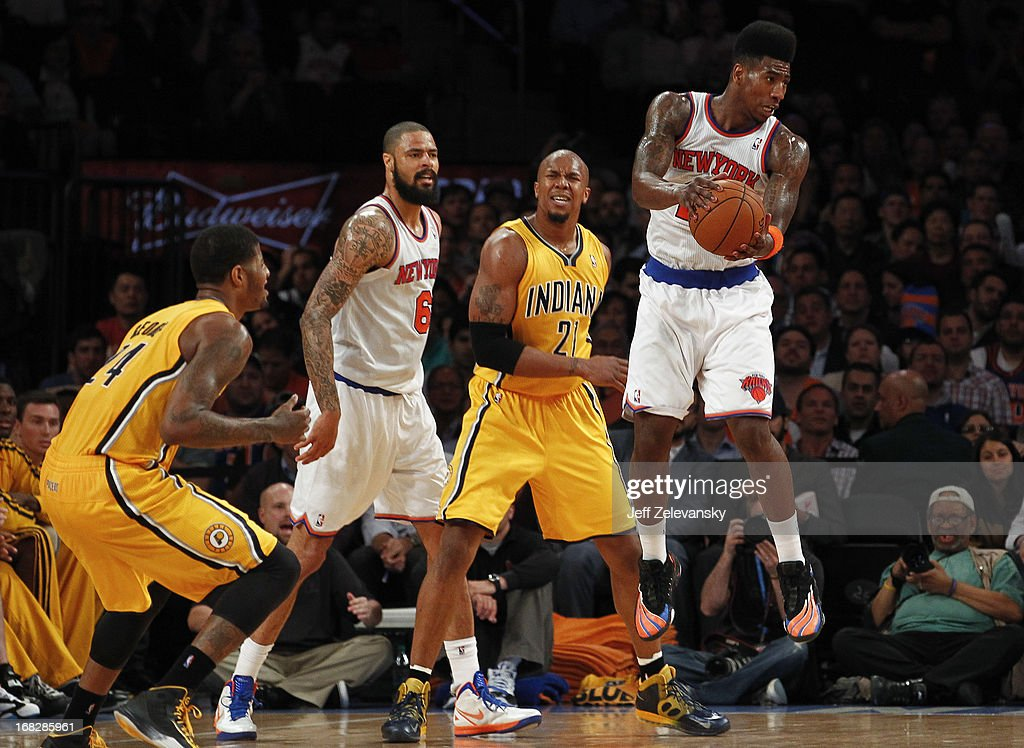 Iman Shumpert #21 of the New York Knicks grabs a loose ball in front of David West #21 of the Indiana Pacers during Game Two of the Eastern Conference Semifinals of the 2013 NBA Playoffs at Madison Square Garden on May 7, 2013 in New York City.