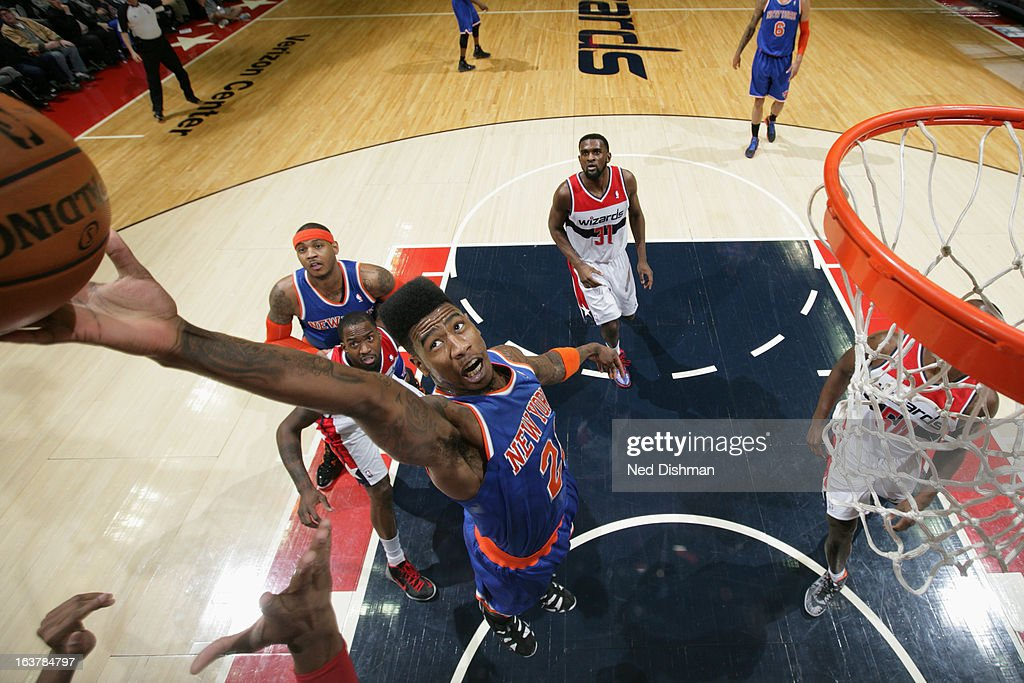 Iman Shumpert #21 of the New York Knicks grabs a rebound against the Washington Wizards at the Verizon Center on March 1, 2013 in Washington, DC.