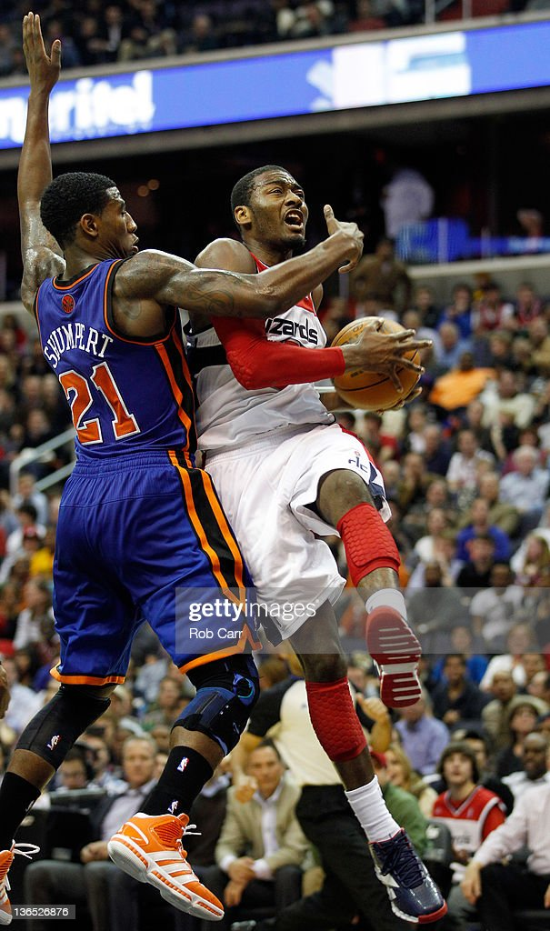 <a gi-track='captionPersonalityLinkClicked' href=/galleries/search?phrase=Iman+Shumpert&family=editorial&specificpeople=5042486 ng-click='$event.stopPropagation()'>Iman Shumpert</a> #21 of the New York Knicks guards <a gi-track='captionPersonalityLinkClicked' href=/galleries/search?phrase=John+Wall&family=editorial&specificpeople=2265812 ng-click='$event.stopPropagation()'>John Wall</a> #2 of the Washington Wizards as he drives to the basket during the second half at Verizon Center on January 6, 2012 in Washington, DC.