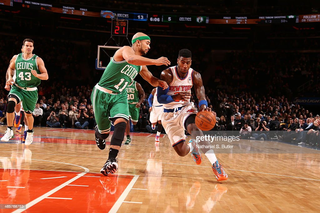 <a gi-track='captionPersonalityLinkClicked' href=/galleries/search?phrase=Iman+Shumpert&family=editorial&specificpeople=5042486 ng-click='$event.stopPropagation()'>Iman Shumpert</a> #21 of the New York Knicks handles the ball against <a gi-track='captionPersonalityLinkClicked' href=/galleries/search?phrase=Jerryd+Bayless&family=editorial&specificpeople=4216027 ng-click='$event.stopPropagation()'>Jerryd Bayless</a> #11 of the Boston Celtics at Madison Square Garden in New York City on January 28, 2014.