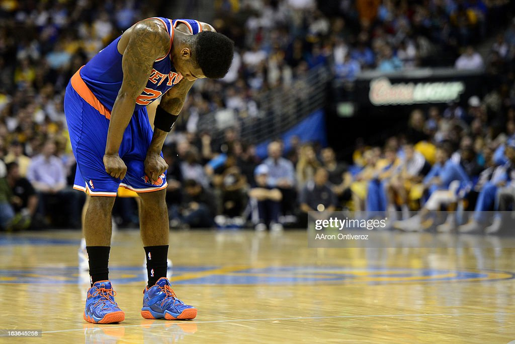 Iman Shumpert (21) of the New York Knicks hangs his head during the second half of of the Nuggets' win. The Denver Nuggets play the New York Knicks at the Pepsi Center.