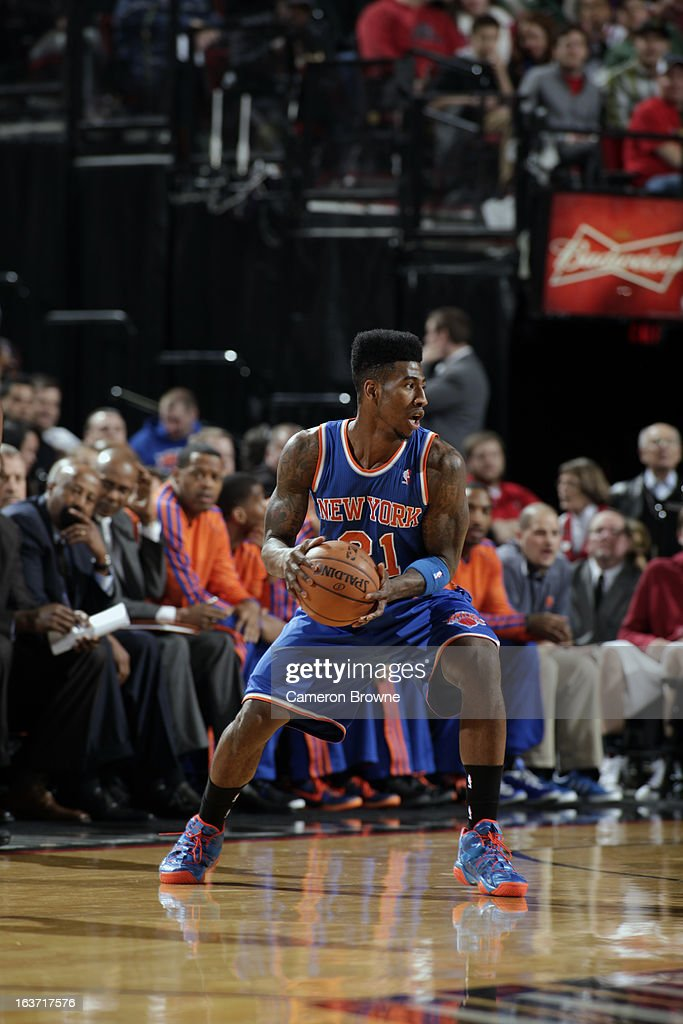 Iman Shumpert #21 of the New York Knicks holds the ball while looking to pass against the Portland Trail Blazers on March 14, 2013 at the Rose Garden Arena in Portland, Oregon.