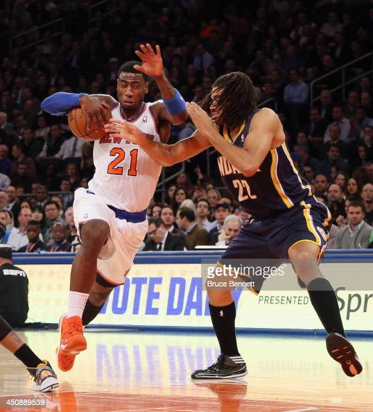 Iman Shumpert of the New York Knicks is fouled by Chris Copeland of the Indiana Pacers during the first half at Madison Square Garden on November 20...