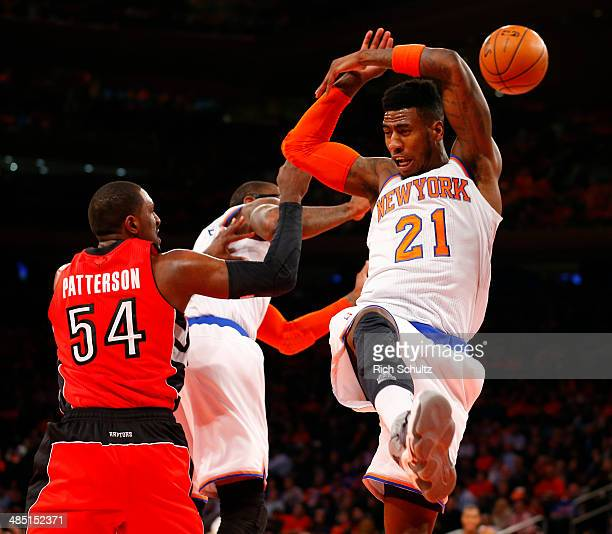 Iman Shumpert of the New York Knicks loses possession of the ball against Patrick Patterson of the Toronto Raptors in the first half during an NBA...