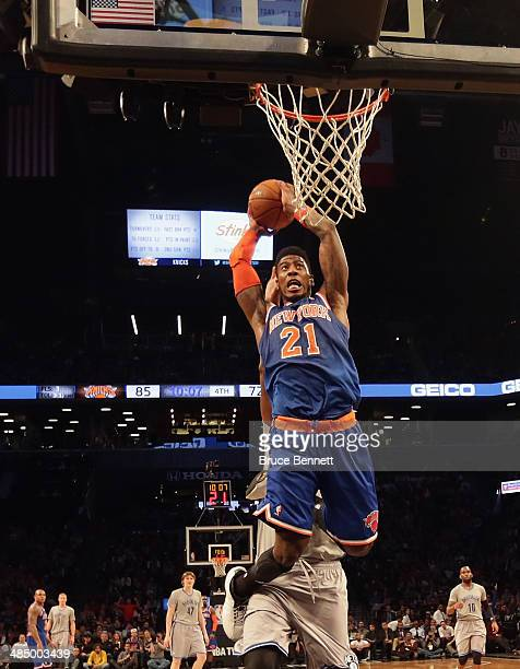 Iman Shumpert of the New York Knicks scores two during the second half against the Brooklyn Nets at the Barclays Center on April 15 2014 in the...