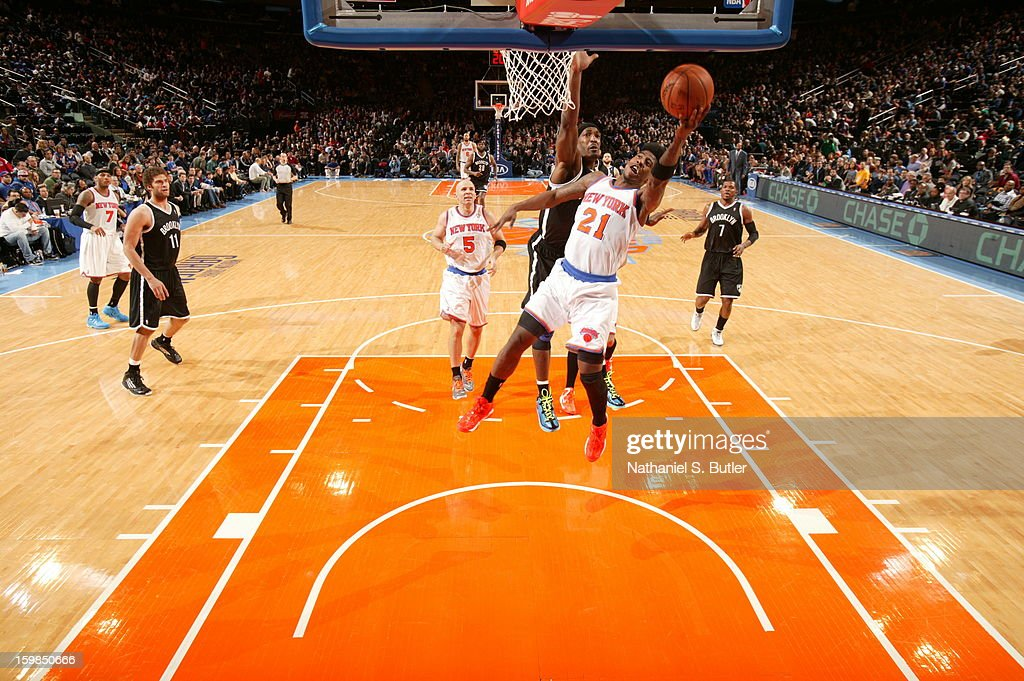 Iman Shumpert #21 of the New York Knicks shoots a layup against Gerald Wallace #45 of the Brooklyn Nets on January 21, 2013 at Madison Square Garden in New York City.