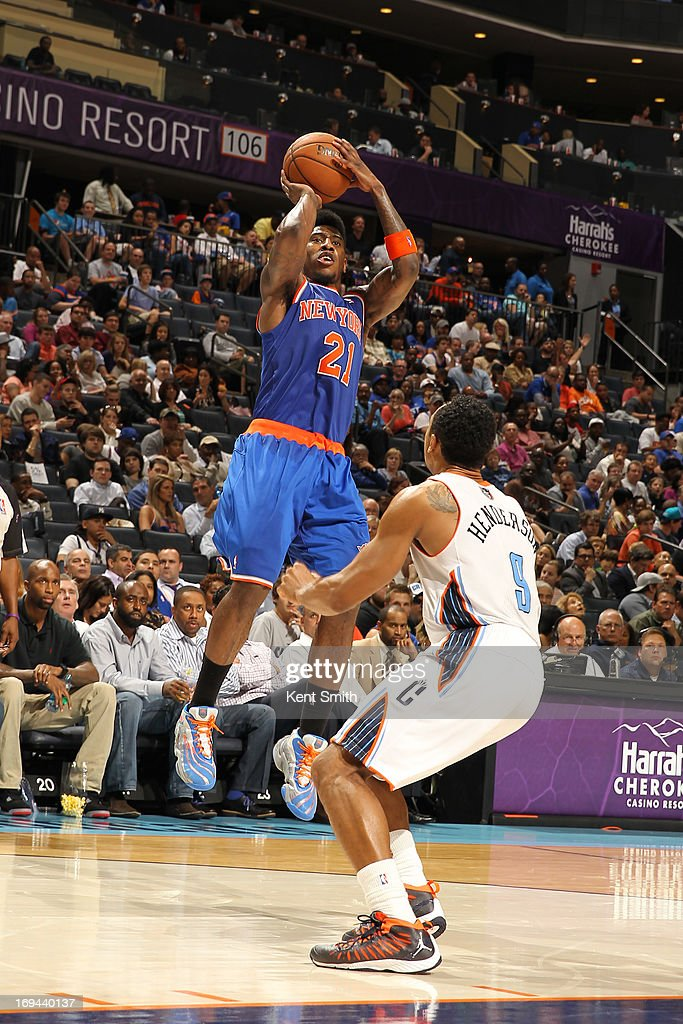 Iman Shumpert #21 of the New York Knicks shoots a three pointer against the Charlotte Bobcats at the Time Warner Cable Arena on April 15, 2013 in Charlotte, North Carolina.