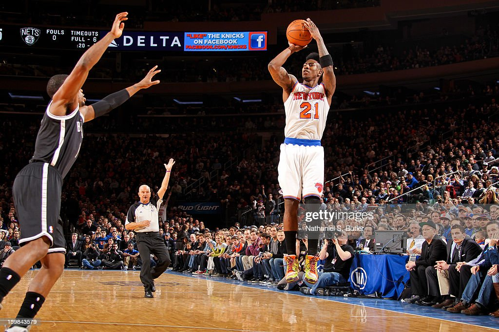 Iman Shumpert #21 of the New York Knicks shoots a three-pointer against the Brooklyn Nets on January 21, 2013 at Madison Square Garden in New York City.