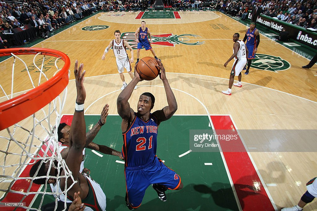 <a gi-track='captionPersonalityLinkClicked' href=/galleries/search?phrase=Iman+Shumpert&family=editorial&specificpeople=5042486 ng-click='$event.stopPropagation()'>Iman Shumpert</a> #21 of the New York Knicks shoots against <a gi-track='captionPersonalityLinkClicked' href=/galleries/search?phrase=Ekpe+Udoh&family=editorial&specificpeople=4185351 ng-click='$event.stopPropagation()'>Ekpe Udoh</a> #13 of the Milwaukee Bucks on April 11, 2012 at the Bradley Center in Milwaukee, Wisconsin.
