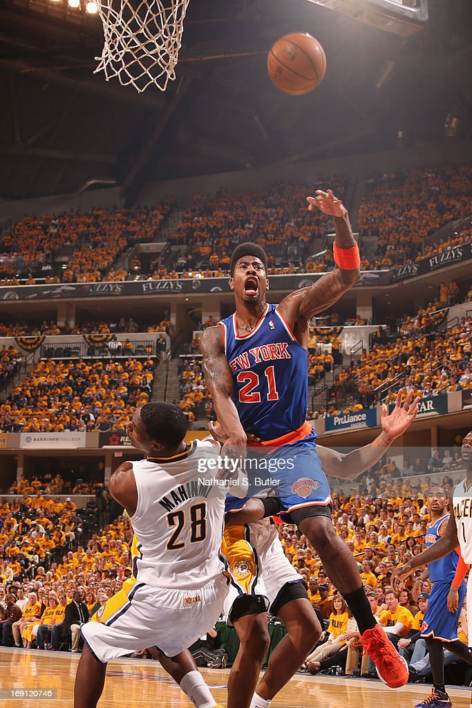 <a gi-track='captionPersonalityLinkClicked' href=/galleries/search?phrase=Iman+Shumpert&family=editorial&specificpeople=5042486 ng-click='$event.stopPropagation()'>Iman Shumpert</a> #21 of the New York Knicks shoots against <a gi-track='captionPersonalityLinkClicked' href=/galleries/search?phrase=Ian+Mahinmi&family=editorial&specificpeople=740196 ng-click='$event.stopPropagation()'>Ian Mahinmi</a> #28 of the Indiana Pacers in Game Six of the Eastern Conference Semifinals during the 2013 NBA Playoffs on May 18, 2013 at Bankers Life Fieldhouse in Indianapolis, Indiana.