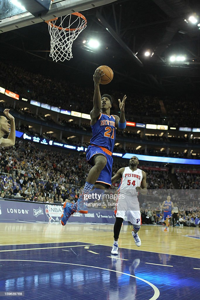Iman Shumpert #21 of the New York Knicks shoots against Jason Maxiell #54 of the Detroit Pistons during a game between the New York Knicks and the Detroit Pistons at the 02 Arena on January 17, 2013 in London, England.