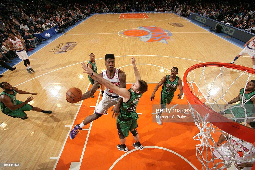 Iman Shumpert #21 of the New York Knicks shoots against Shavlik Randolph #42 of the Boston Celtics on March 31, 2013 at Madison Square Garden in New York City.
