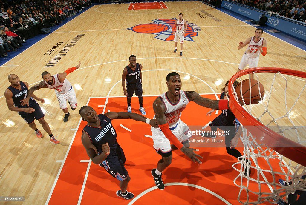 <a gi-track='captionPersonalityLinkClicked' href=/galleries/search?phrase=Iman+Shumpert&family=editorial&specificpeople=5042486 ng-click='$event.stopPropagation()'>Iman Shumpert</a> #21 of the New York Knicks shoots during a preseason game against the Charlotte Bobcats on October 25, 2013 at Madison Square Garden in New York City.