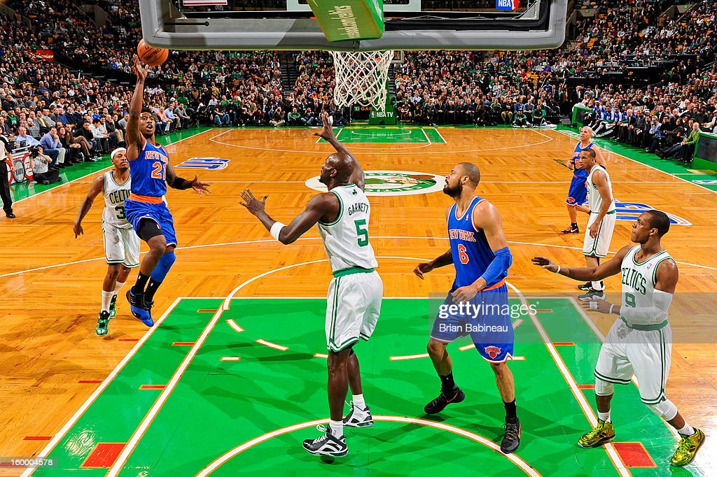 Iman Shumpert #21 of the New York Knicks shoots in the lane against Kevin Garnett #5 of the Boston Celtics on January 24, 2013 at the TD Garden in Boston, Massachusetts.