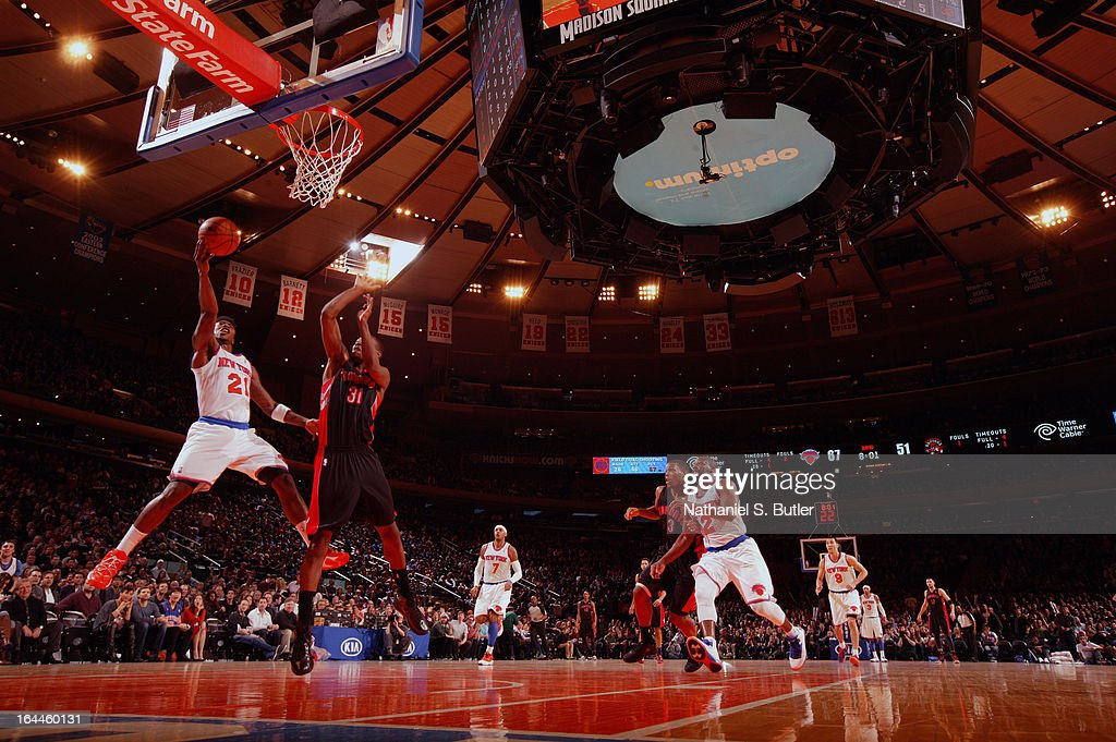 <a gi-track='captionPersonalityLinkClicked' href=/galleries/search?phrase=Iman+Shumpert&family=editorial&specificpeople=5042486 ng-click='$event.stopPropagation()'>Iman Shumpert</a> #21 of the New York Knicks shoots over <a gi-track='captionPersonalityLinkClicked' href=/galleries/search?phrase=Terrence+Ross&family=editorial&specificpeople=6781663 ng-click='$event.stopPropagation()'>Terrence Ross</a> #31 of the Toronto Raptors on March 23, 2013 at Madison Square Garden in New York City.